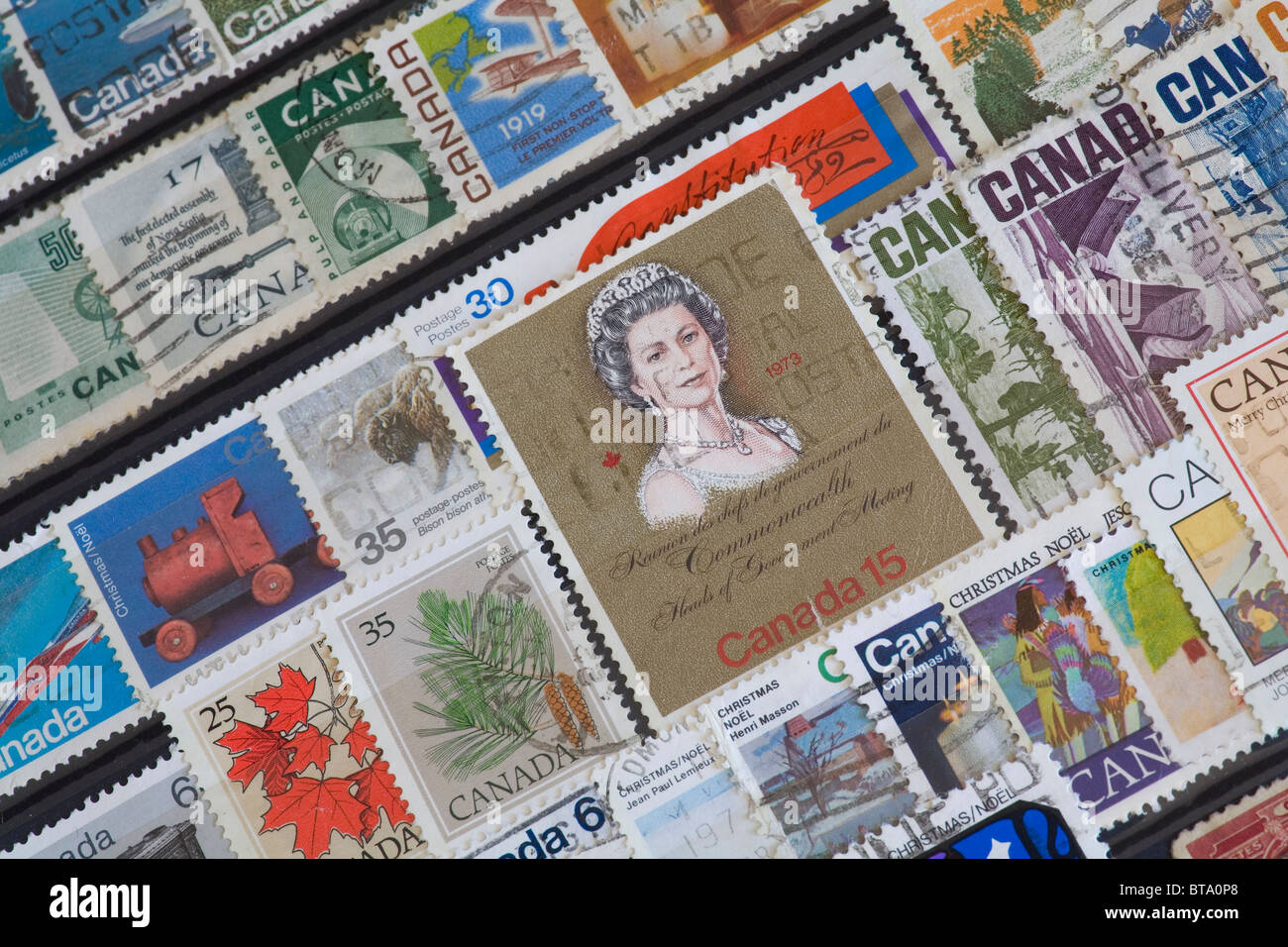 Canadian postage stamps with 1973 stamp showing Queen Elizabeth - Stock Image