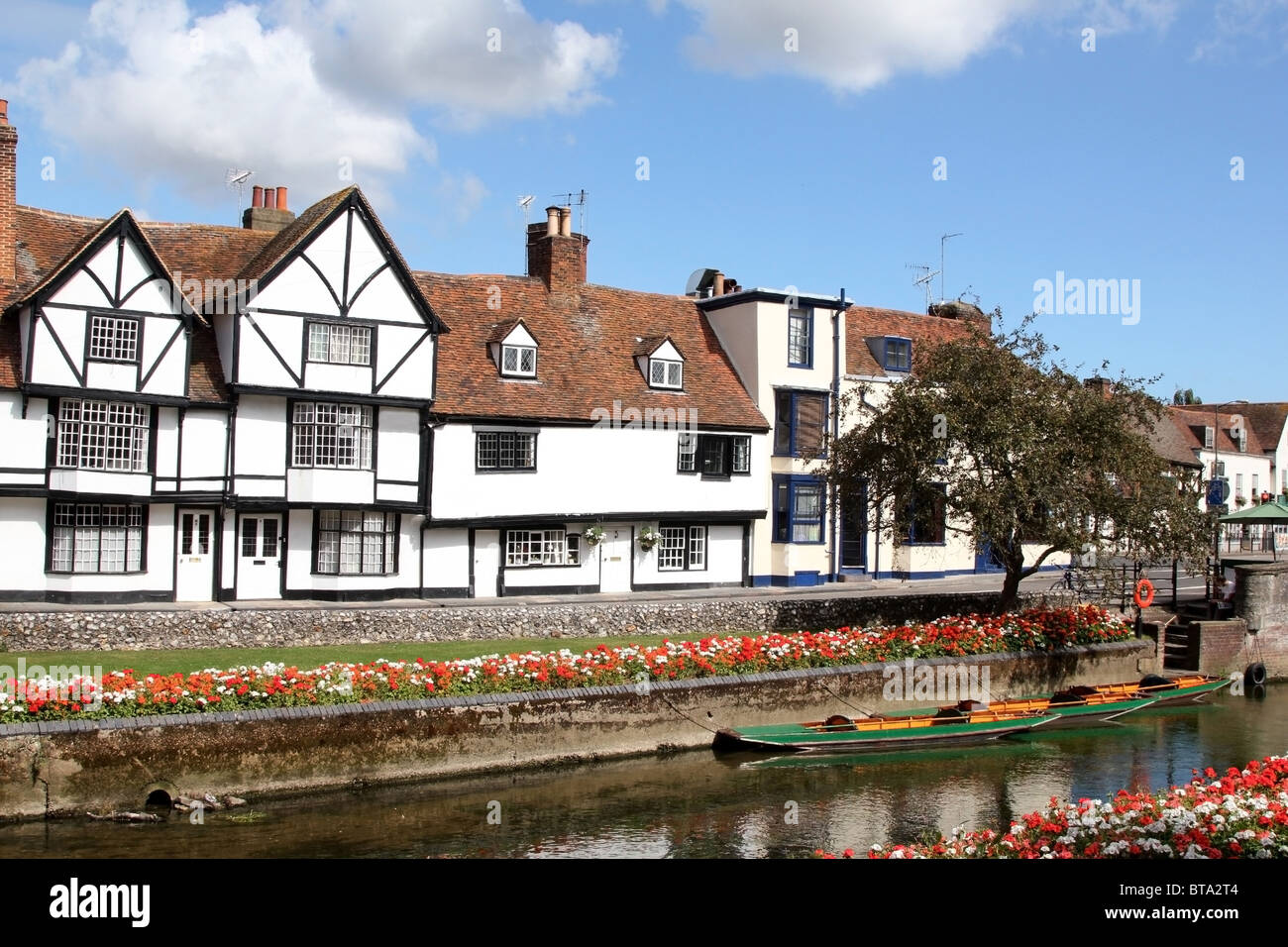 A row of terraced Tudor buildings overlooking the Westgate Gardens and the River Stour in Canterbury, Kent, UK - Stock Image
