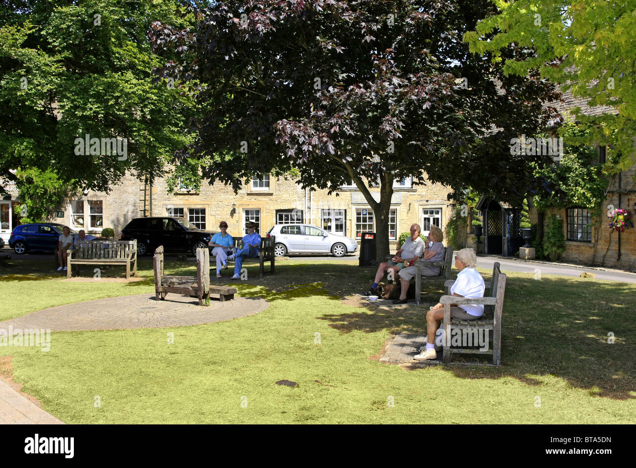 The village green with medieval stocks at Stow-On-The-Wold Gloucestershire Stock Photo