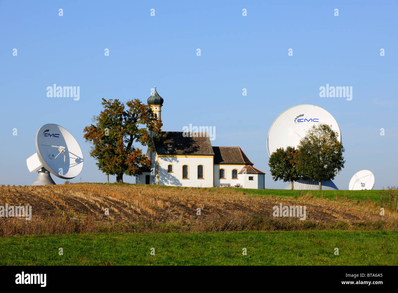 Earth station, parabolic aerial, pilgrimage church St. Johannes, Raisting, Bavaria, Germany, Europe Stock Photo