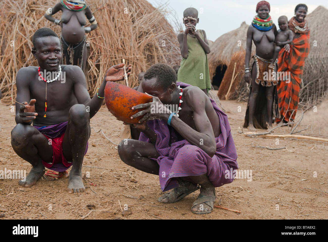 Nyangatom (Bumi) man drinking a mix of blood and milk, Omo river valley, Ethiopia Stock Photo