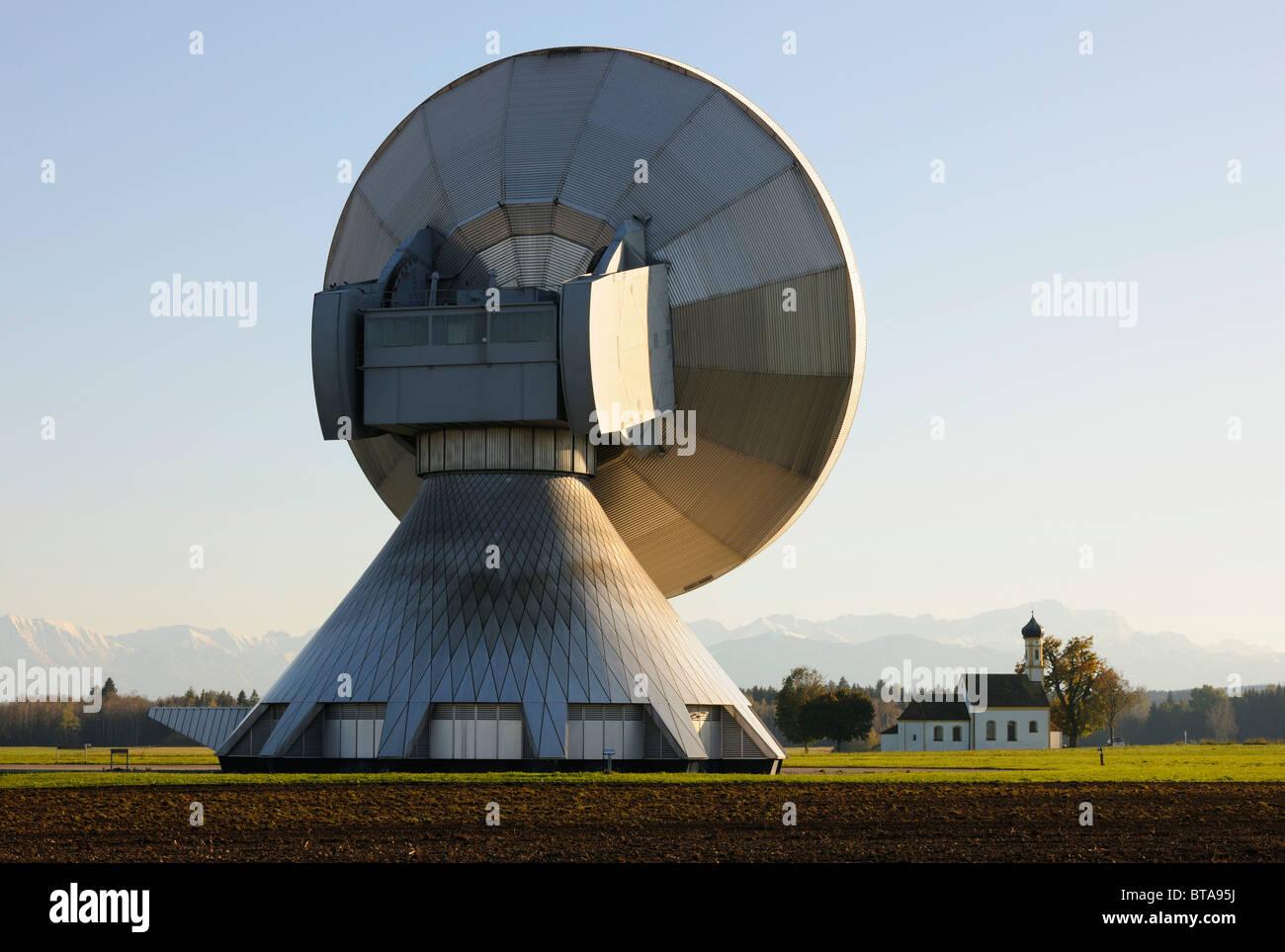 Earth station, parabolic aerial, pilgrimage church St. Johannes, Raisting, Bavaria, Germany, Europe Stock Photo