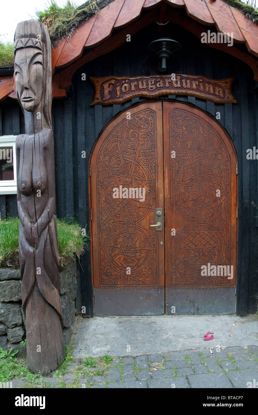 Iceland Reykjanes Hafnarfjordur Viking Village. Carved wooden Viking pole and ornate doors. & Iceland Reykjanes Hafnarfjordur Viking Village. Carved wooden ...