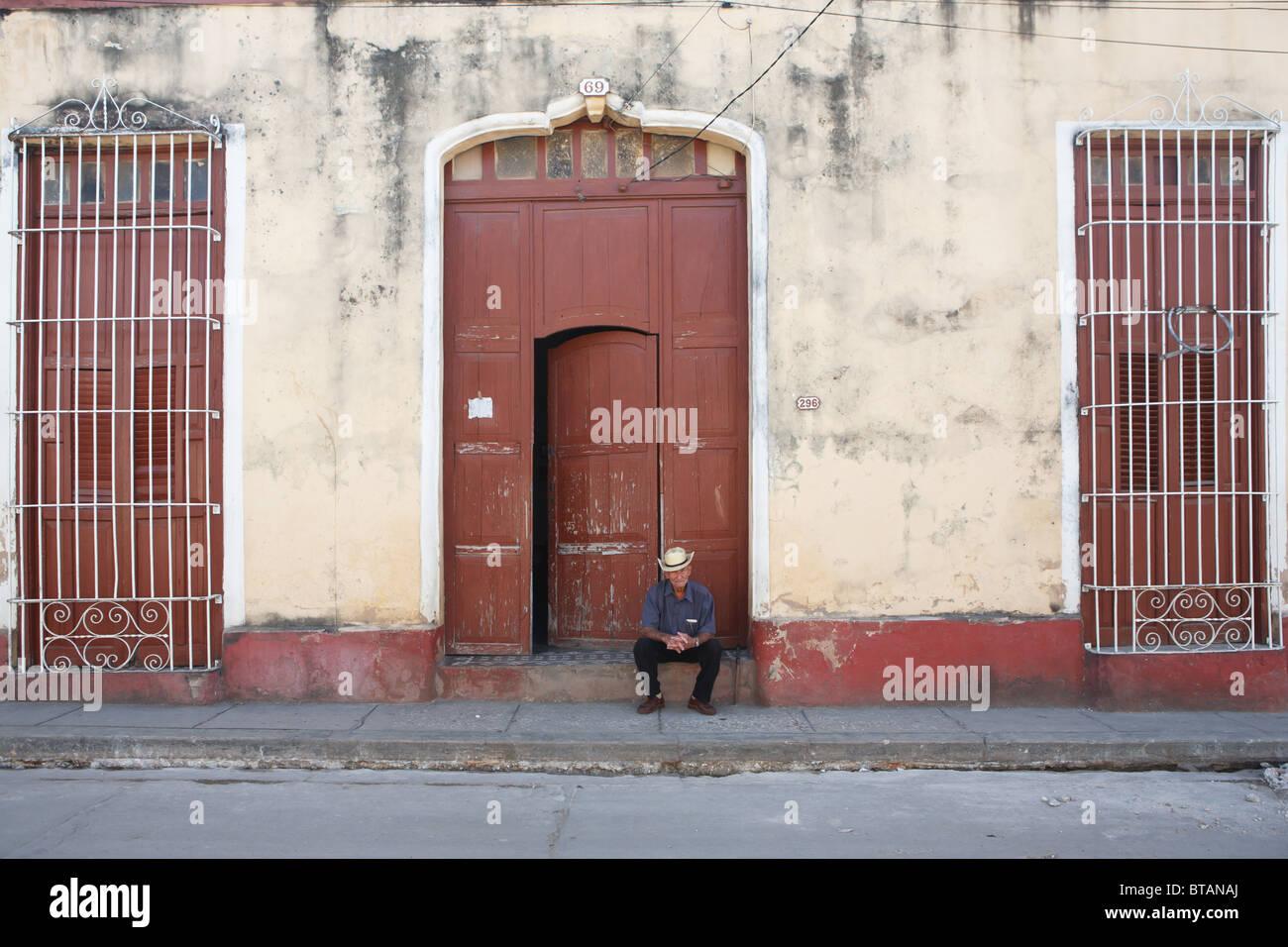 TRINIDAD: CUBAN MAN SITTING IN DOORWAY - Stock Image