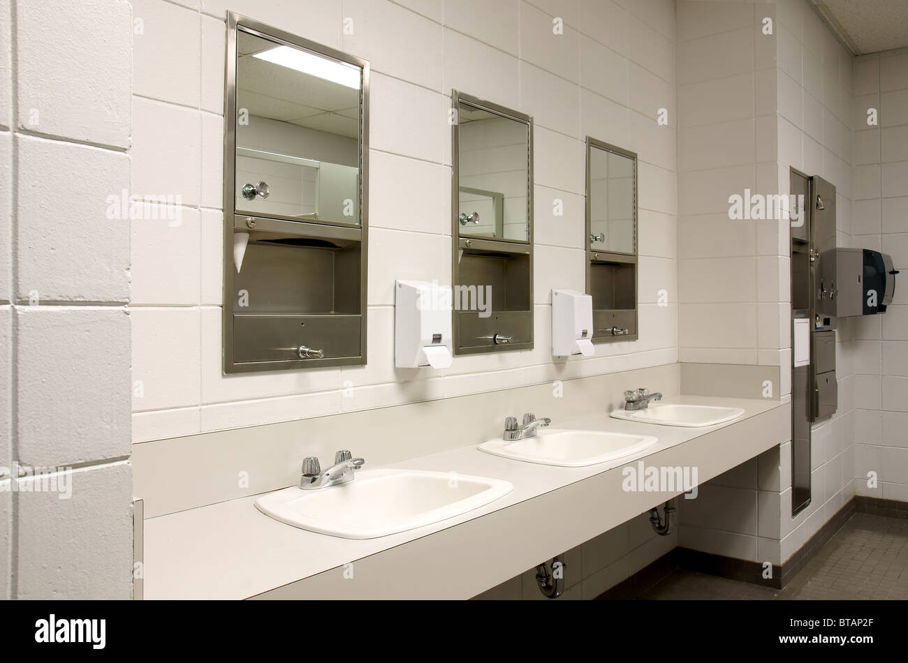 perspective shot of a counter top with three sinks and