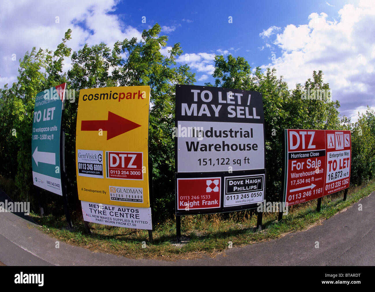 numerous for sale and to let signs on industrial estate leeds yorkshire uk - Stock Image