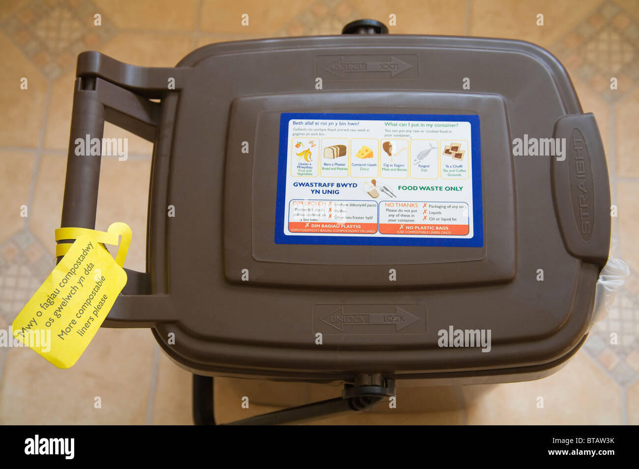 Close up recycled food container with request for more compostable bags - Stock Image