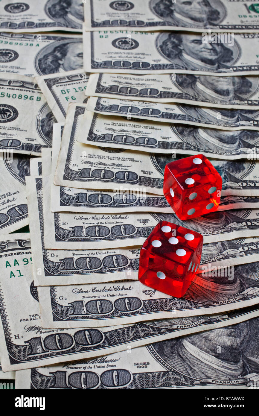 Dice on one hundred dollars bills - Stock Image