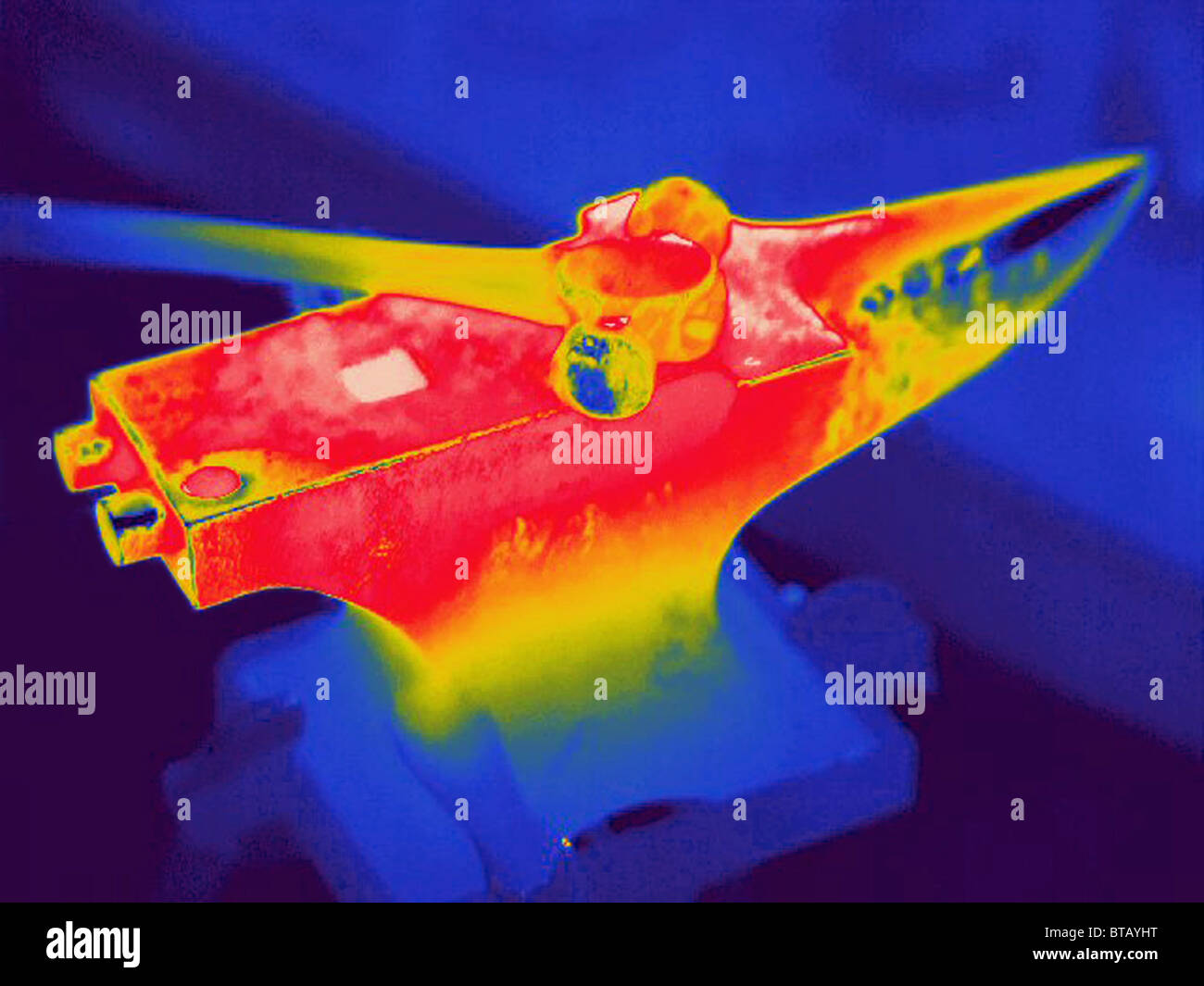 thermal image of a hot hammer and anvil - Stock Image