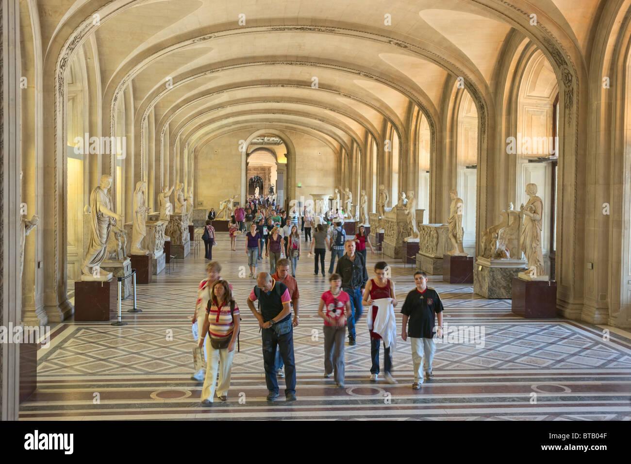 Group of tourists visitors entering Louvre Museum Paris - Stock Image