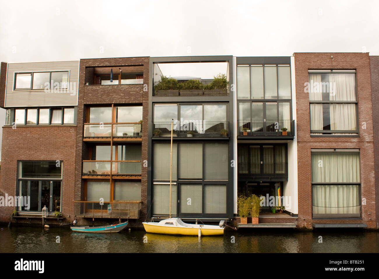 Unique architecture in in Scheepstimmermanstraat, Amsterdam. Row houses with all different modern facades - Stock Image