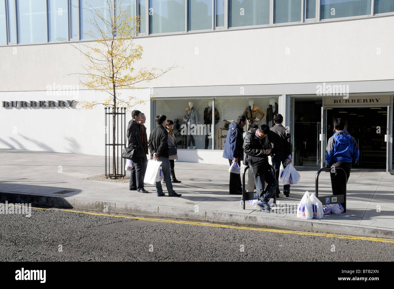 new product c4678 ddd90 Shoppers at the Burberry outlet store in Hackney, east ...