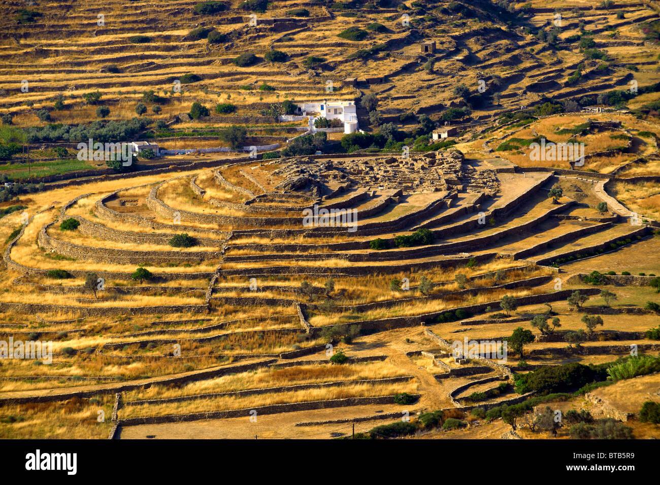 Skarkos hill prehistoric settlement ruins. European Union Cultural Heritage archaeological site of Skarkos - Stock Image