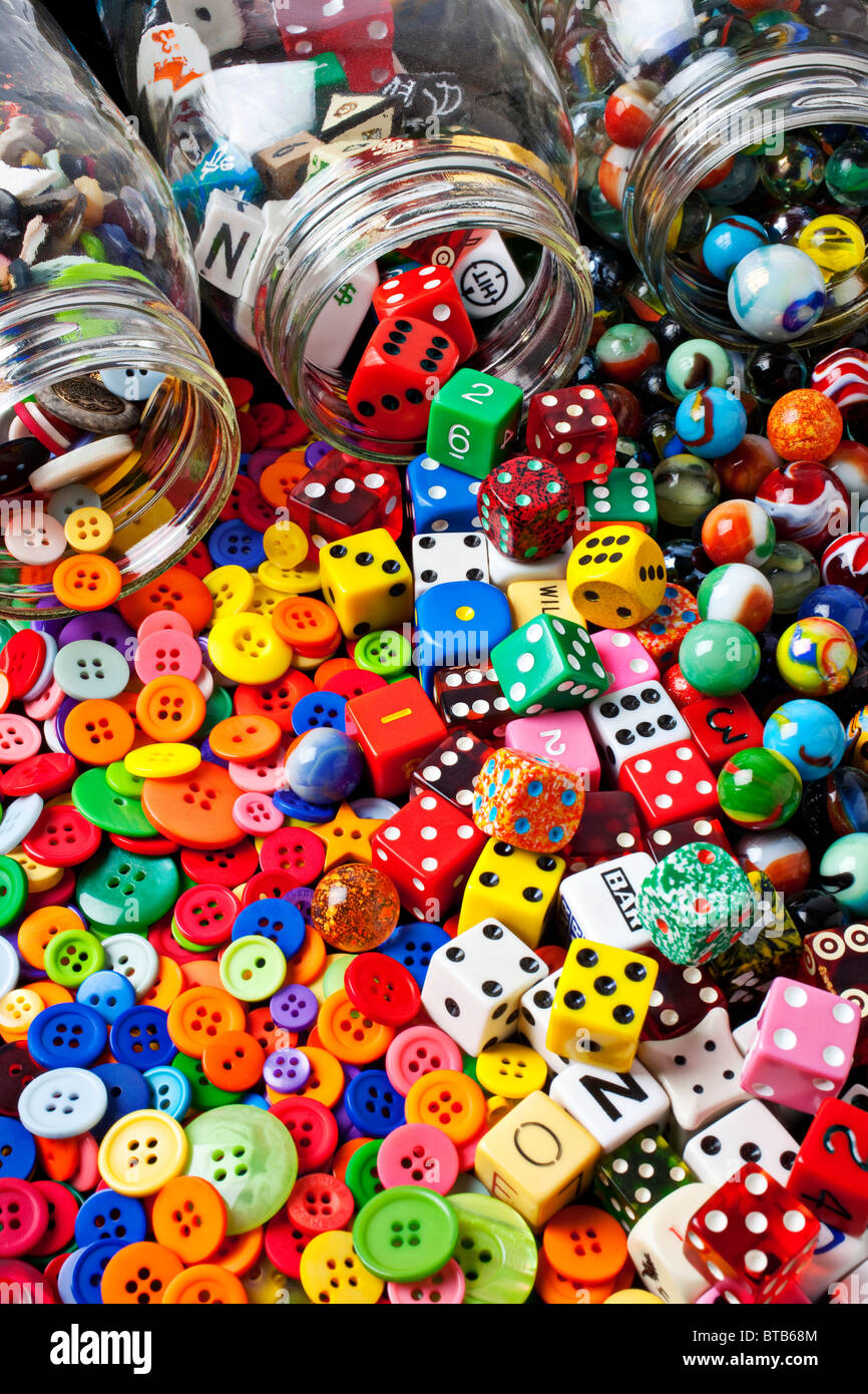 Three jars of buttons, dice and marbles - Stock Image