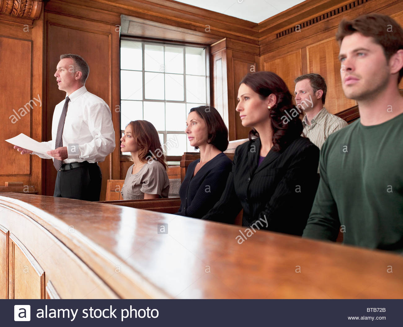 Jury sitting in courtroom - Stock Image