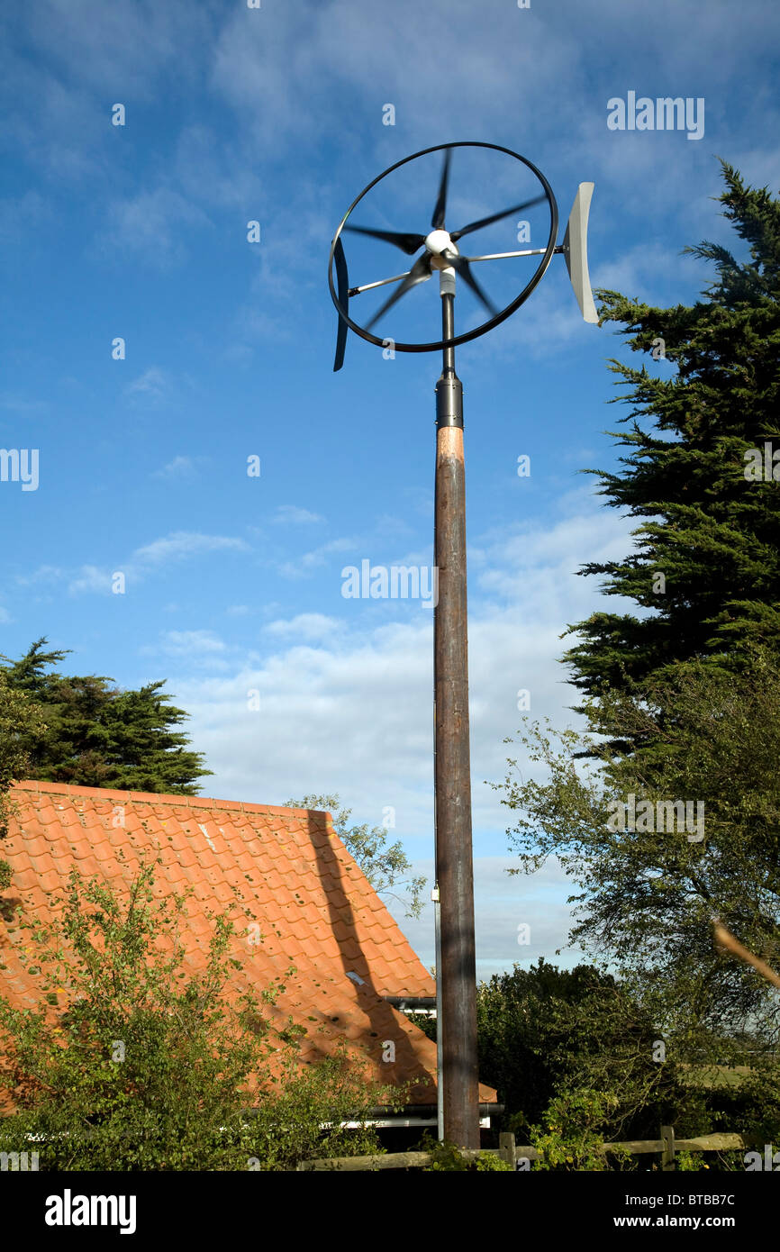 Domestic wind turbine generating electricity for home use - Stock Image