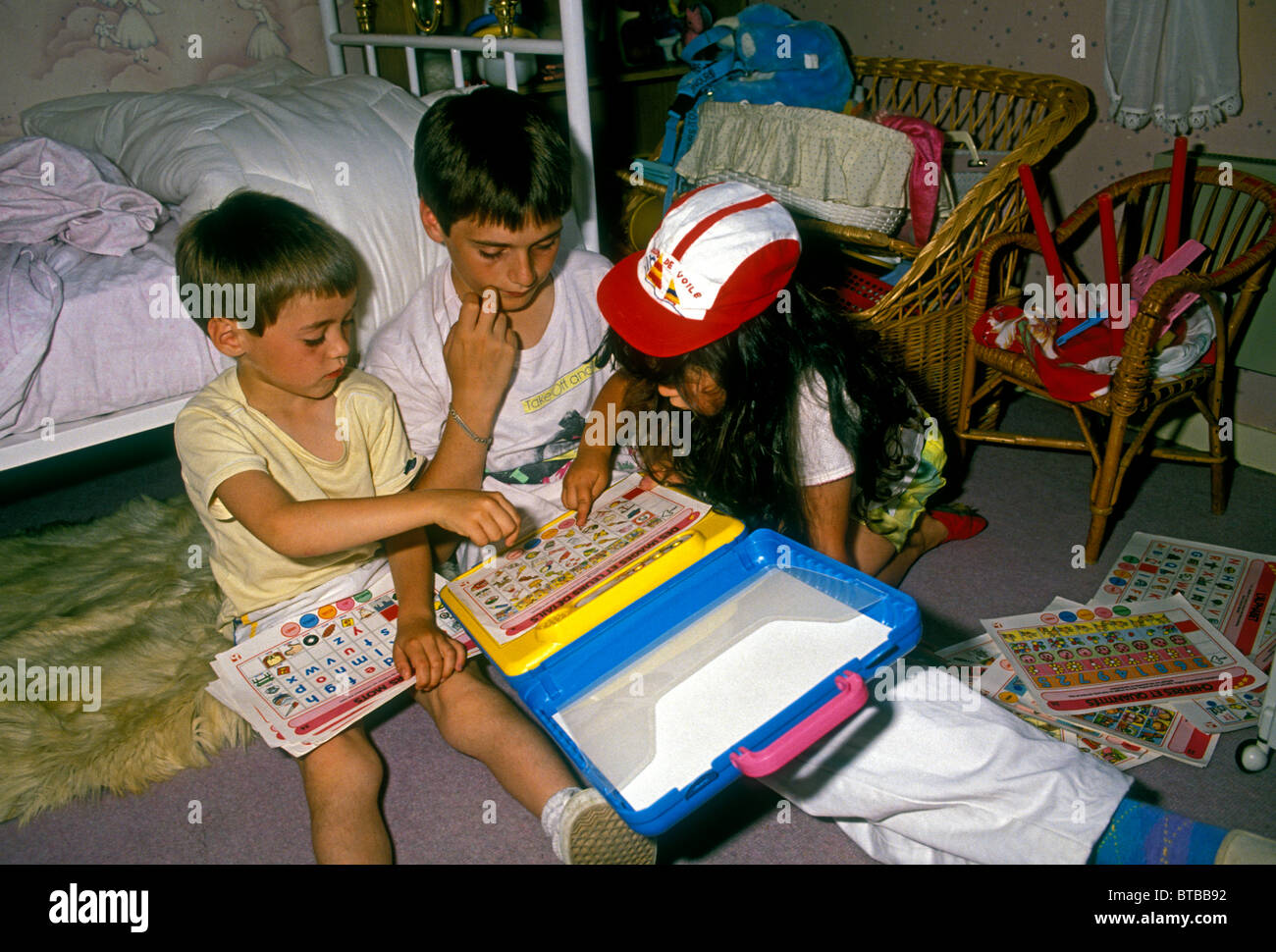 French people children boys and girl playing in bedroom town of Verneuil-sur-Seine Ile-de-France region France Europe - Stock Image