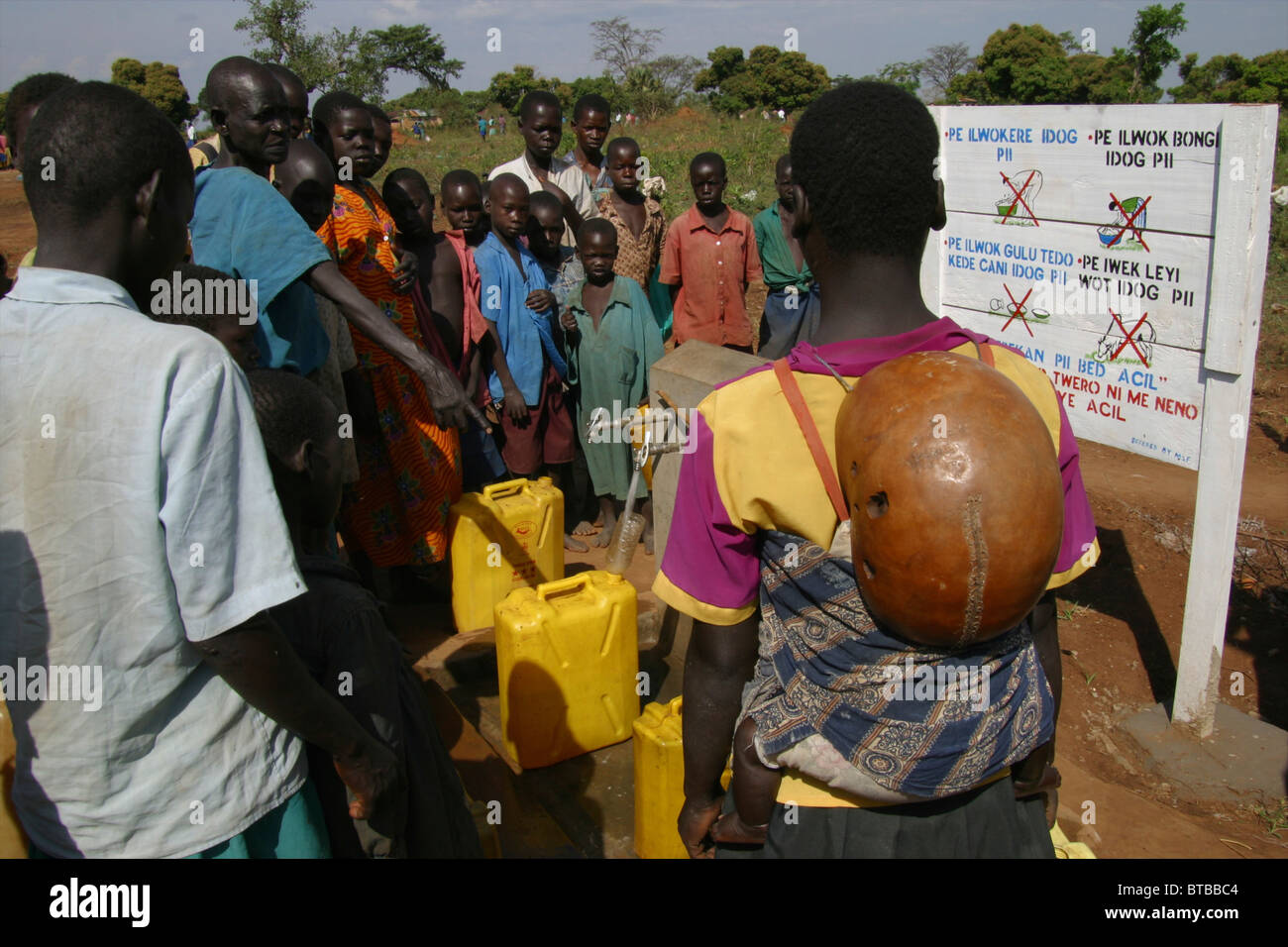 fetching water in uganda - Stock Image