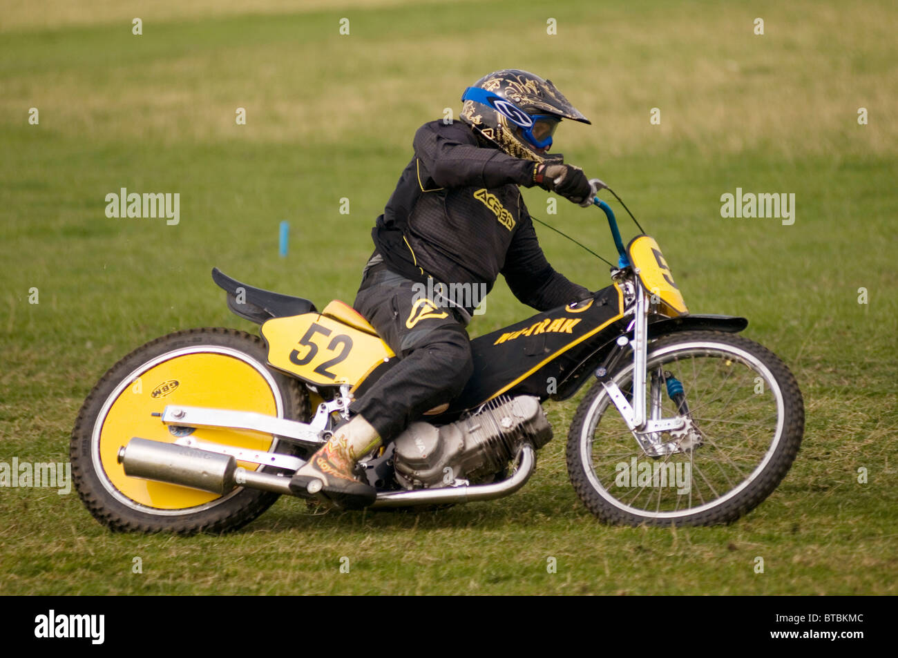 grass track speedway bike at speed - Stock Image