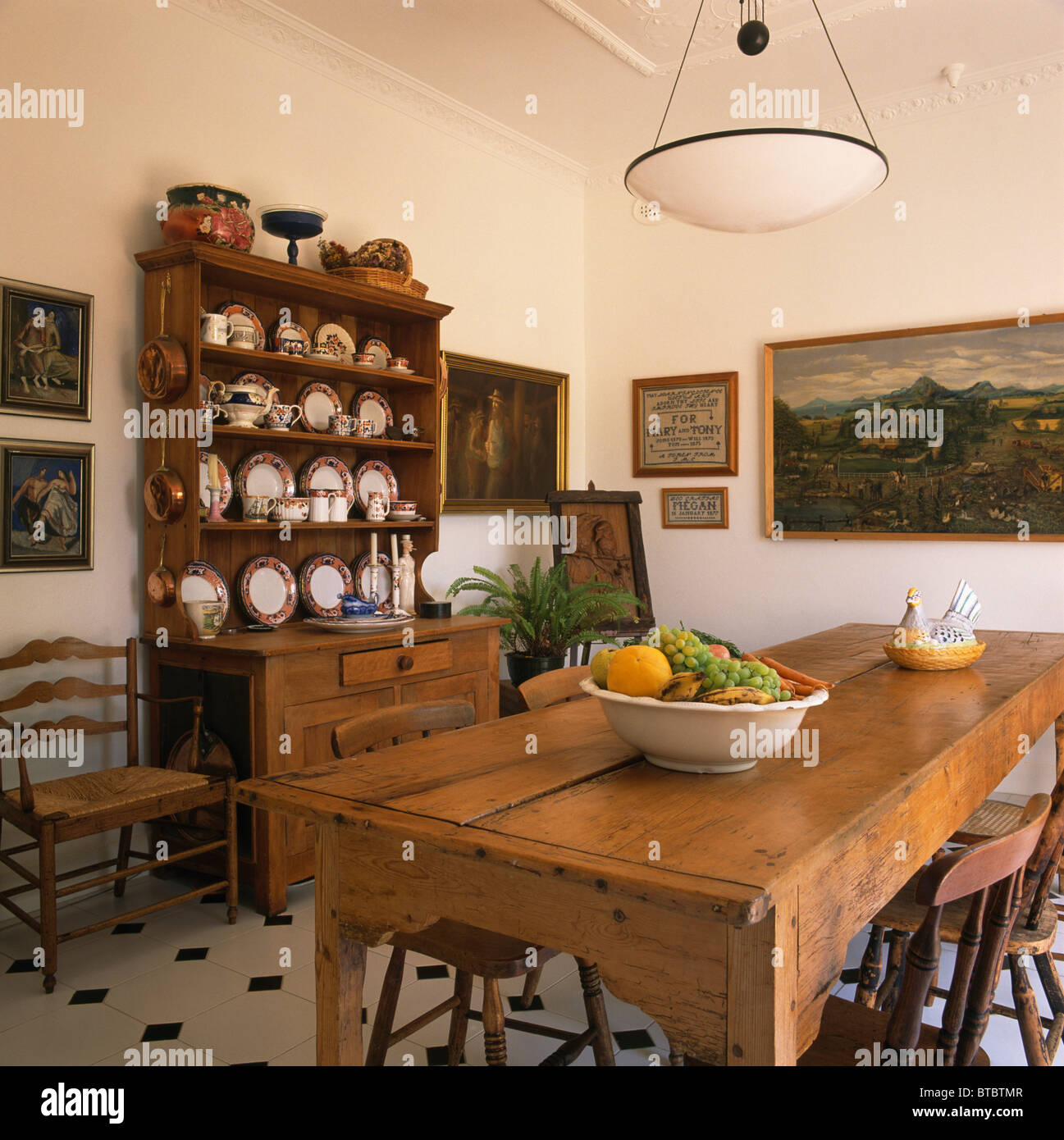 Antique Pine Table And Large Dresser In Traditional Dining Room With Large  Painting On The Wall