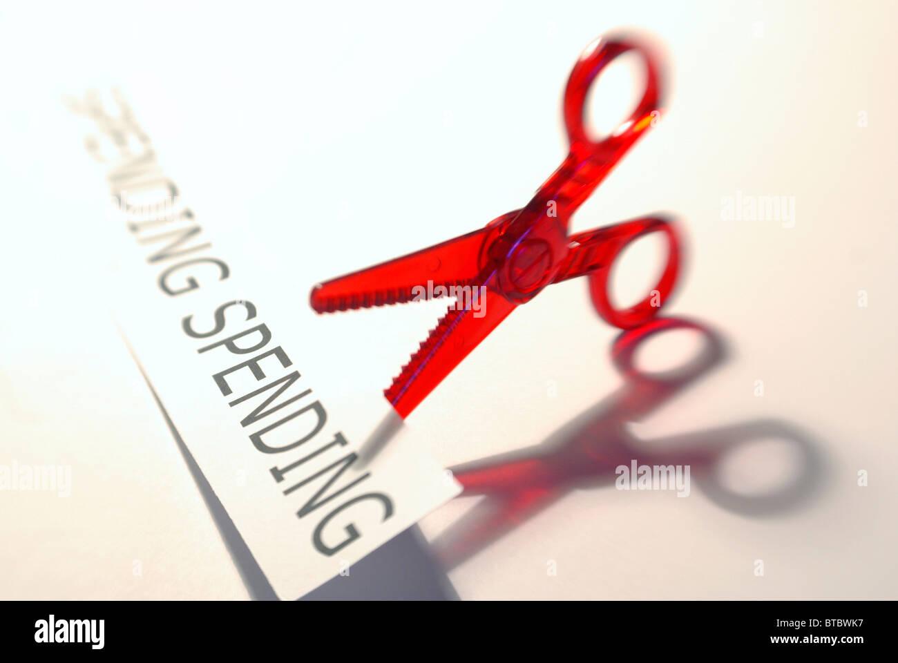Brexit,Spending cuts concept featuring scissors and spending graphic - Stock Image