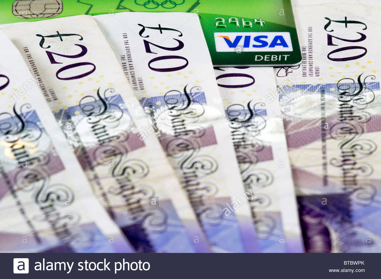 british uk 20 pound notes with a visa debit card - Stock Image