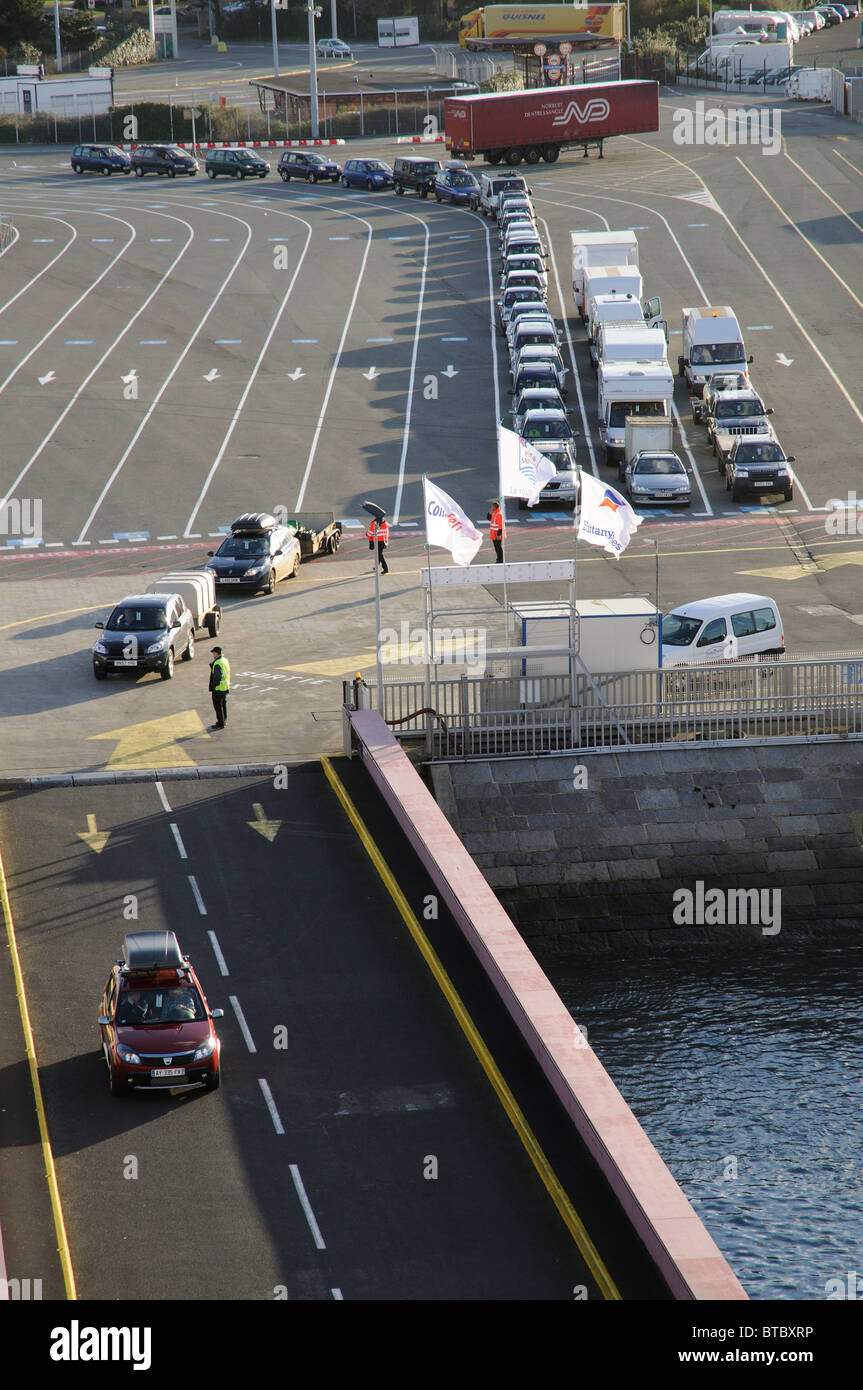 St Malo western France cross channel port a car using the linkspan to board a roro ferry - Stock Image