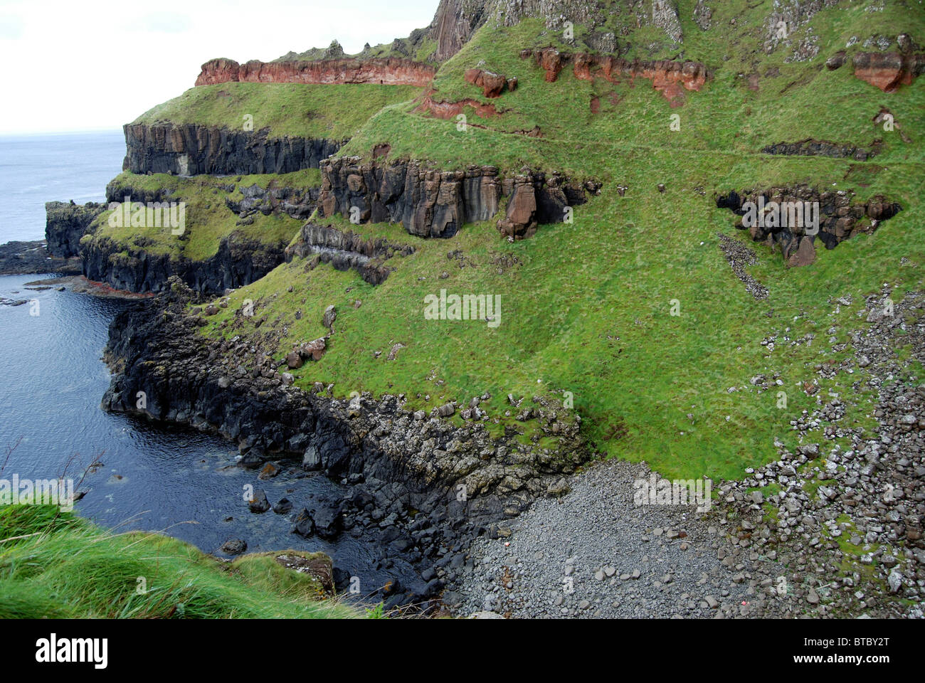 Cliff formations at the Giants Causeway, County Antrim, Northern Ireland - Stock Image