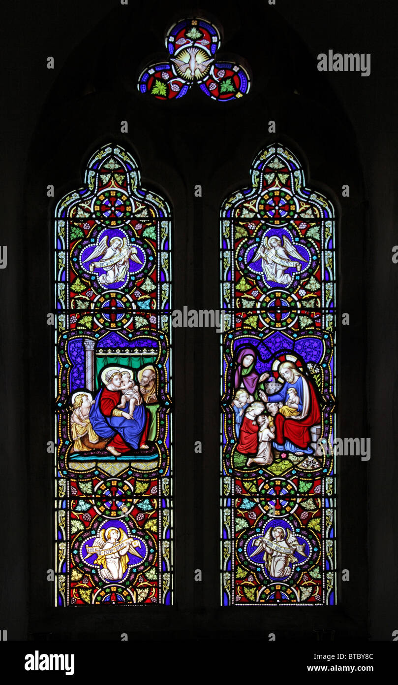 A Stained Glass Window depicting Suffer the little children to come unto me, Parish Church of St Peter, Satterleigh, - Stock Image