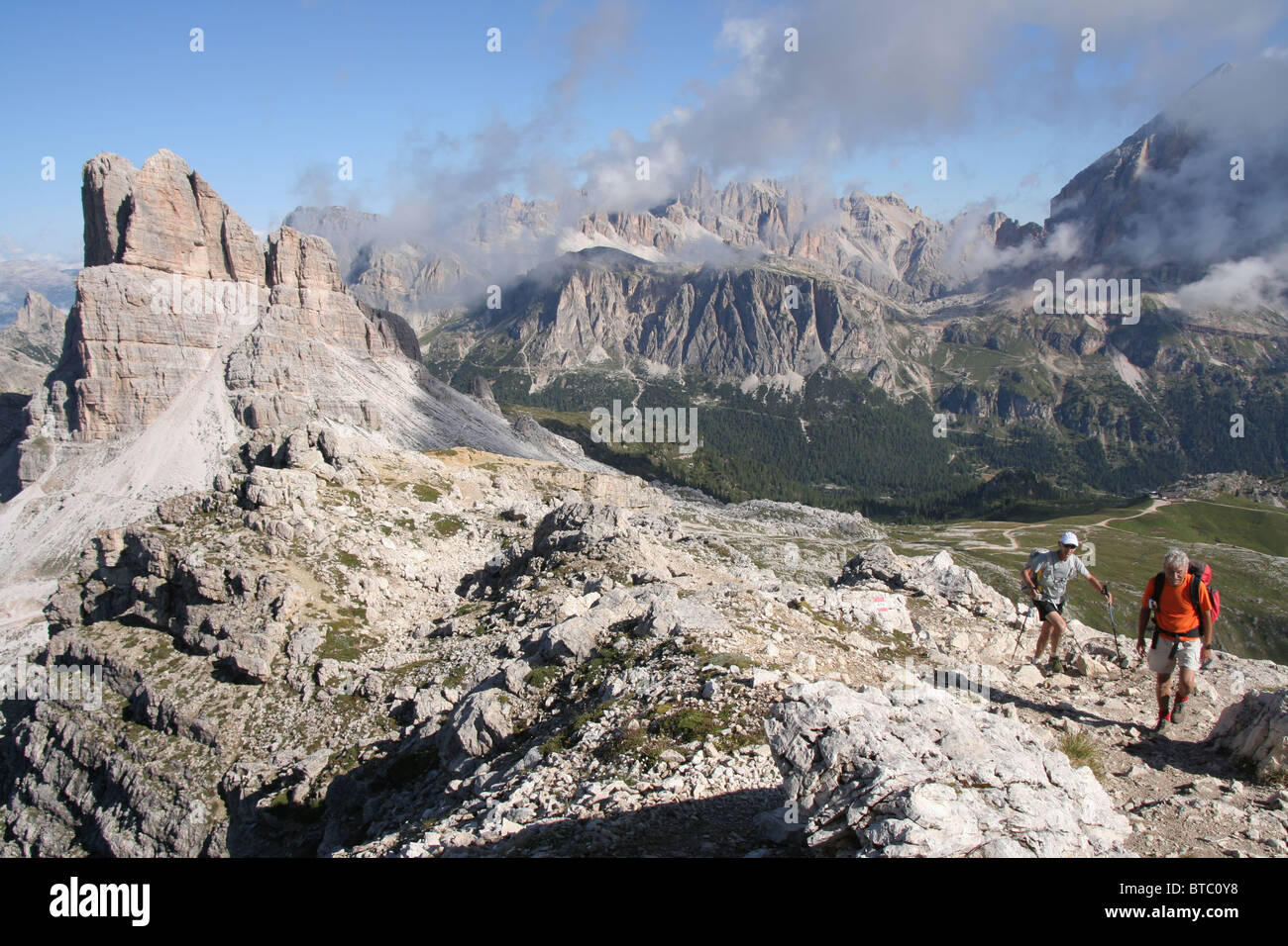 walkers and the Averau mountain in the Italian Dolomites - Stock Image