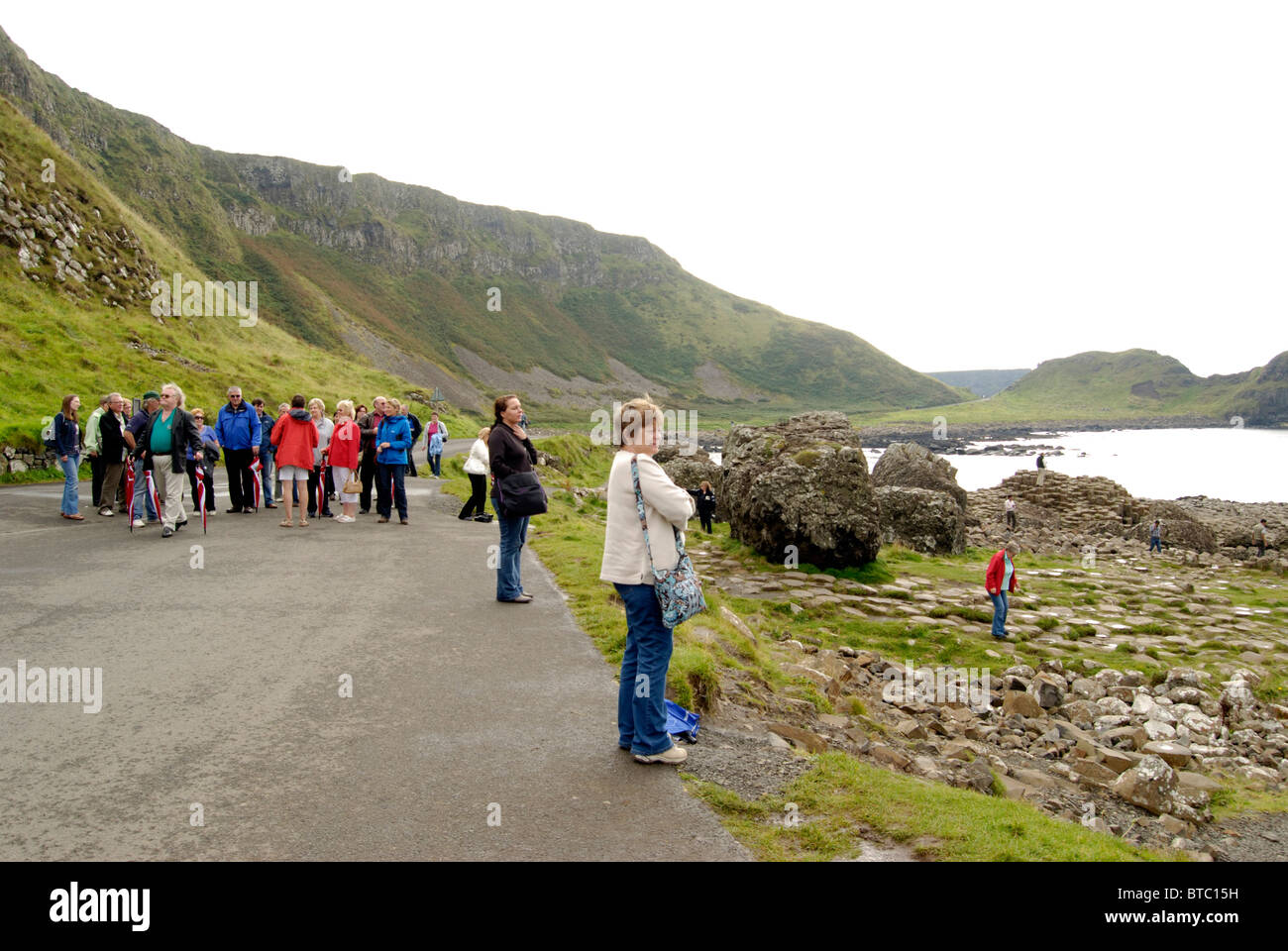 Visitors at the Giants Causeway, County Antrim, Northern Ireland - Stock Image
