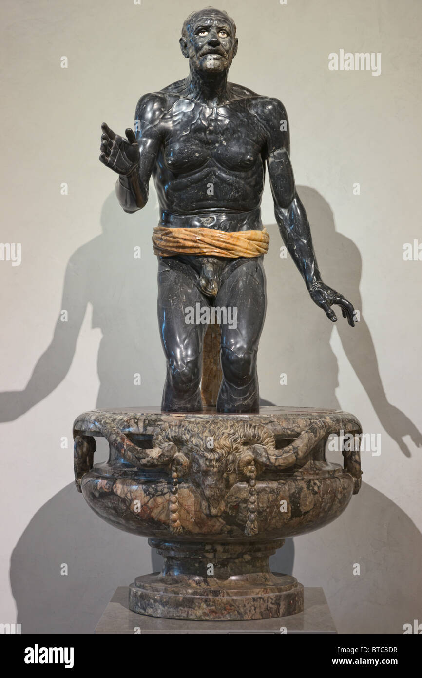 Old Fisherman or Seneca Dying, second century CE. Black marble and alabaster Roman statue in Louvre Museum Paris - Stock Image