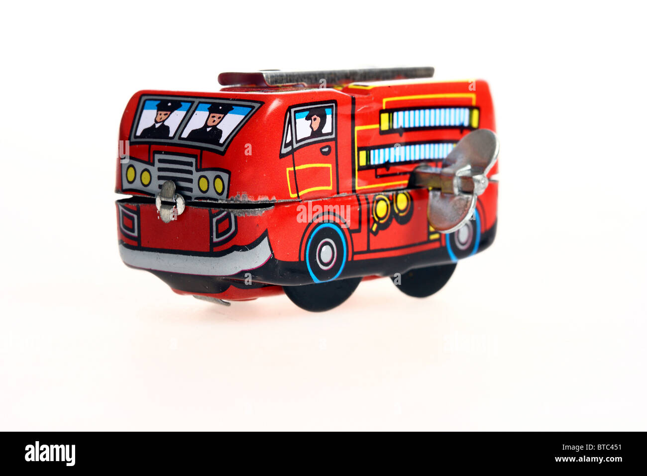 Tin toy, fire engine, wind up motor by a metal key. Stock Photo
