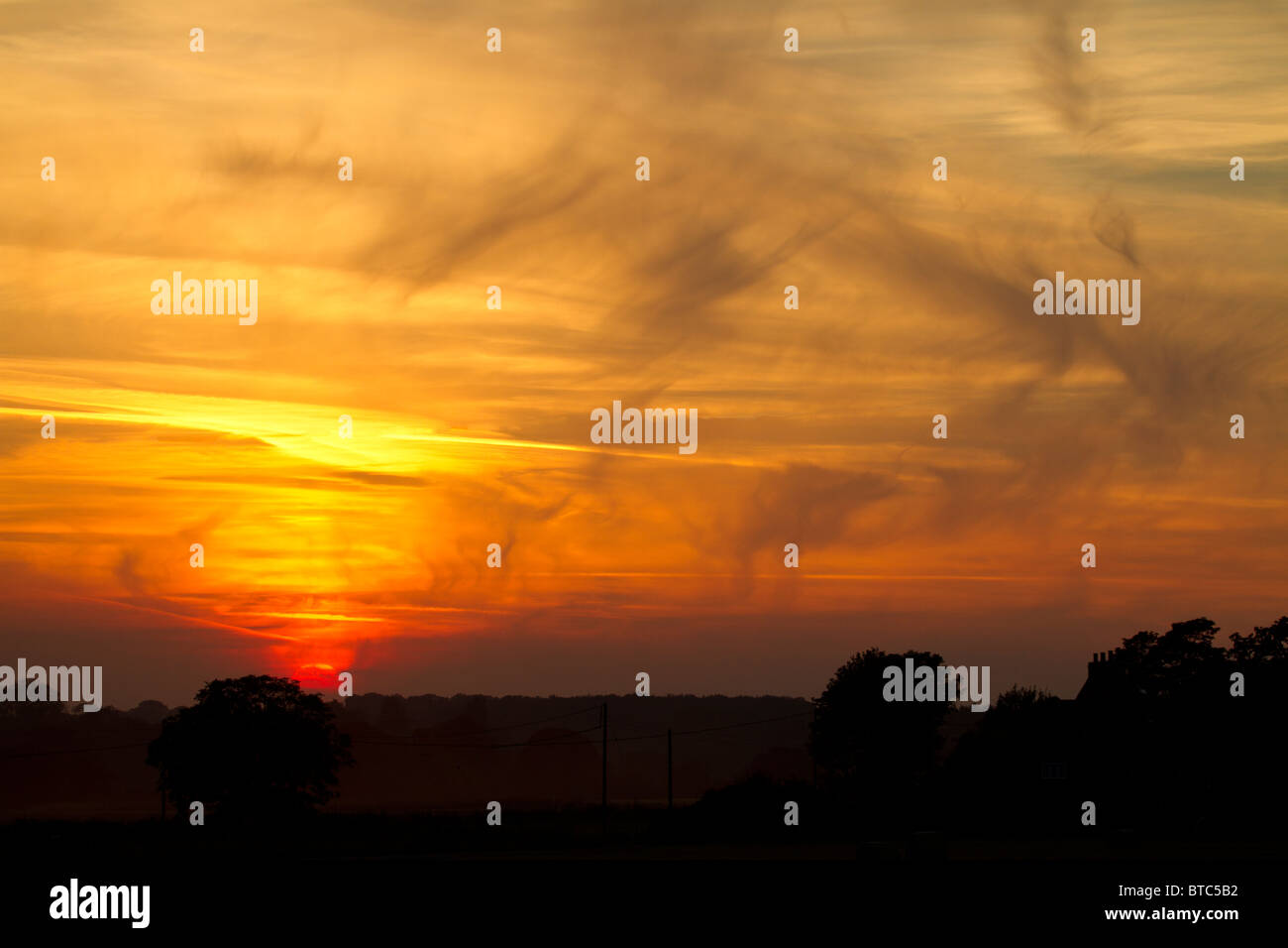 Sunset at Ingworth, Norfolk, England, UK. Late summer. - Stock Image