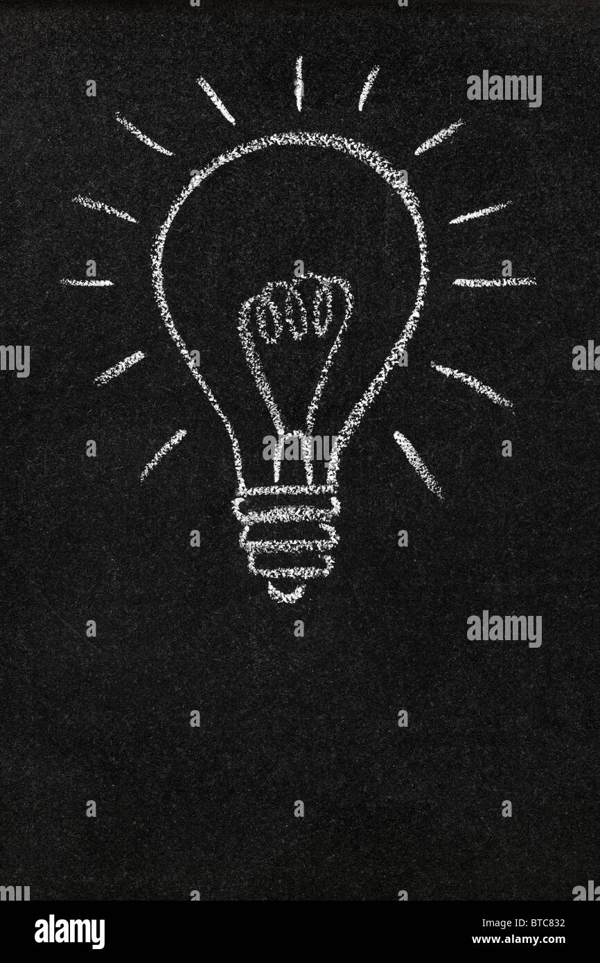 Light bulb drawn on a blackboard with copy space - Stock Image