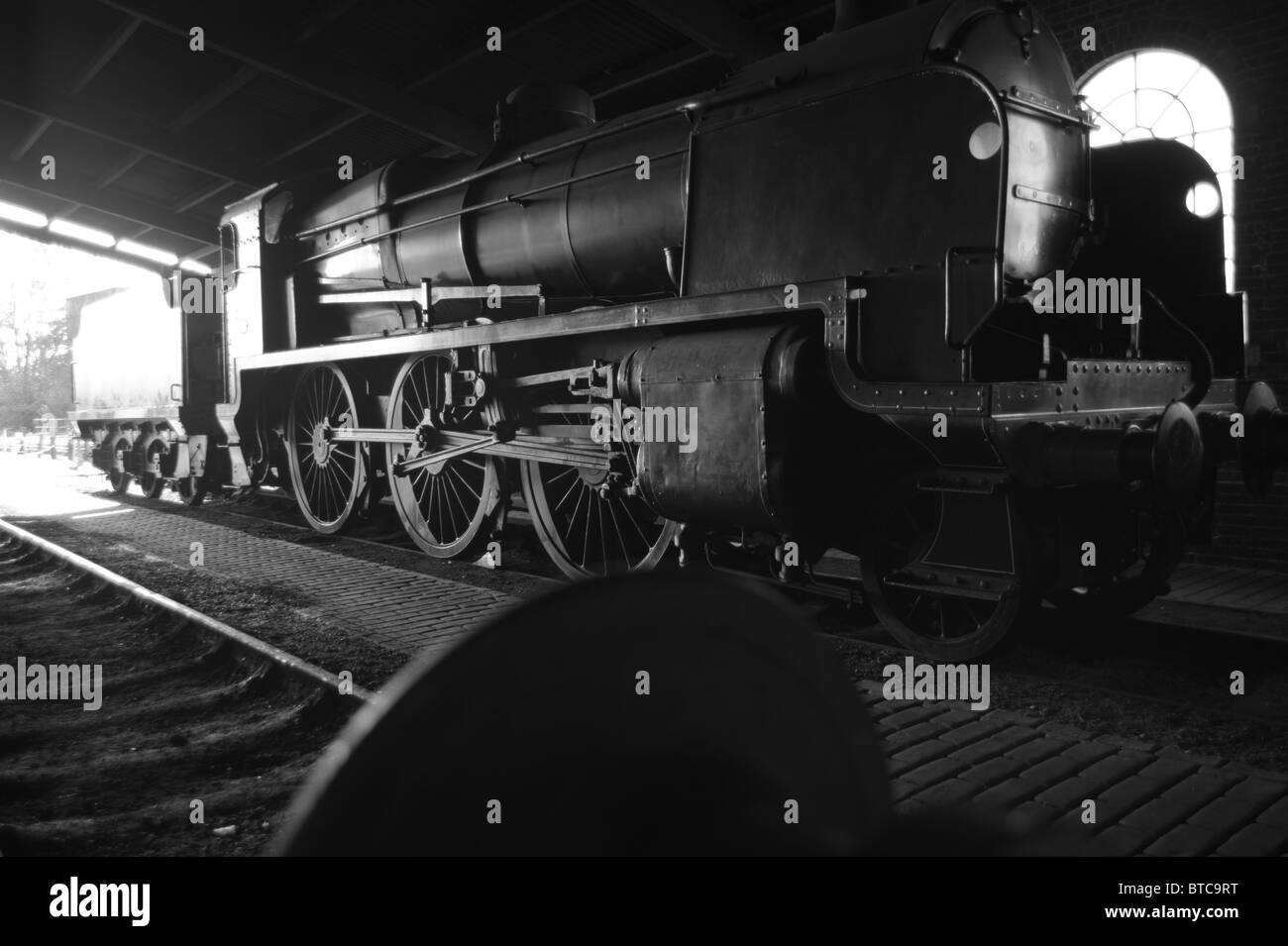 SR Maunsell U-Class Steam Locomotive, No 1618, in the engine shed at Sheffield Park, Bluebell Heritage Railway, - Stock Image