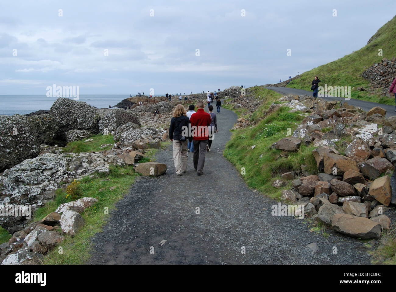 Visitors to the Giants Causeway, County Antrim, Northern Ireland - Stock Image