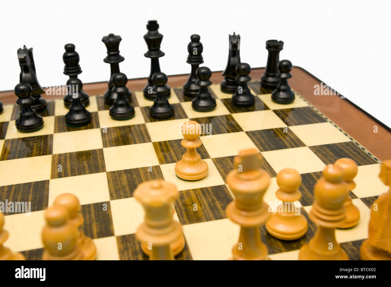 Starting chess match with kings pawn opening - Stock Image