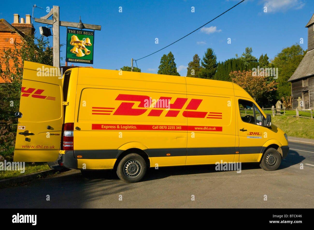 a554d6ab6821a6 A Yellow DHL Delivery Van Parked With The Back Doors Open Stock ...