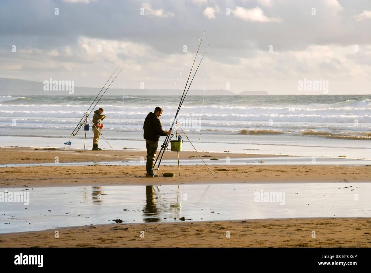 Fishermen at Sandy Mouth near Bude, Cornwall, UK - Stock Image