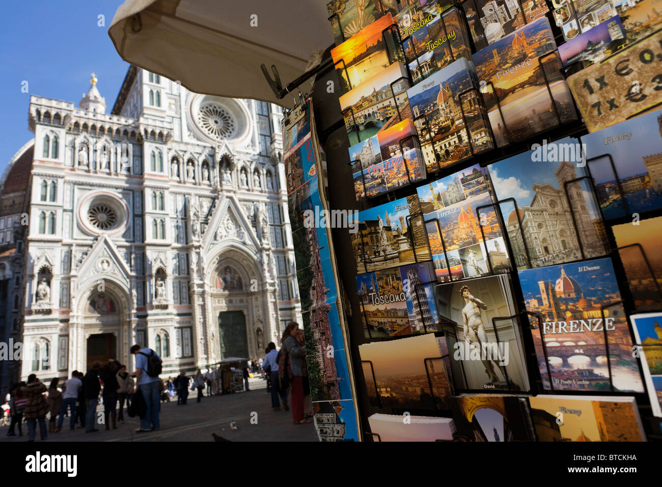 Postcards rack in Piazza Santa Giovanni beneath Florence's Santa Maria del Fiore (Duomo) Cathedral. - Stock Image