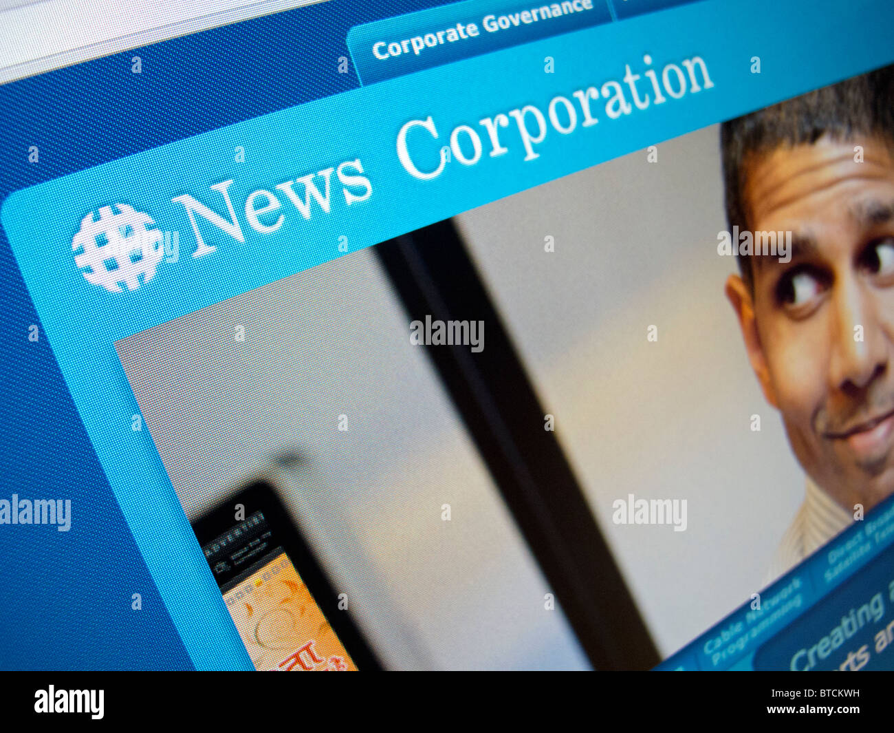 Screenshot from homepage of News Corporation media multinational website - Stock Image