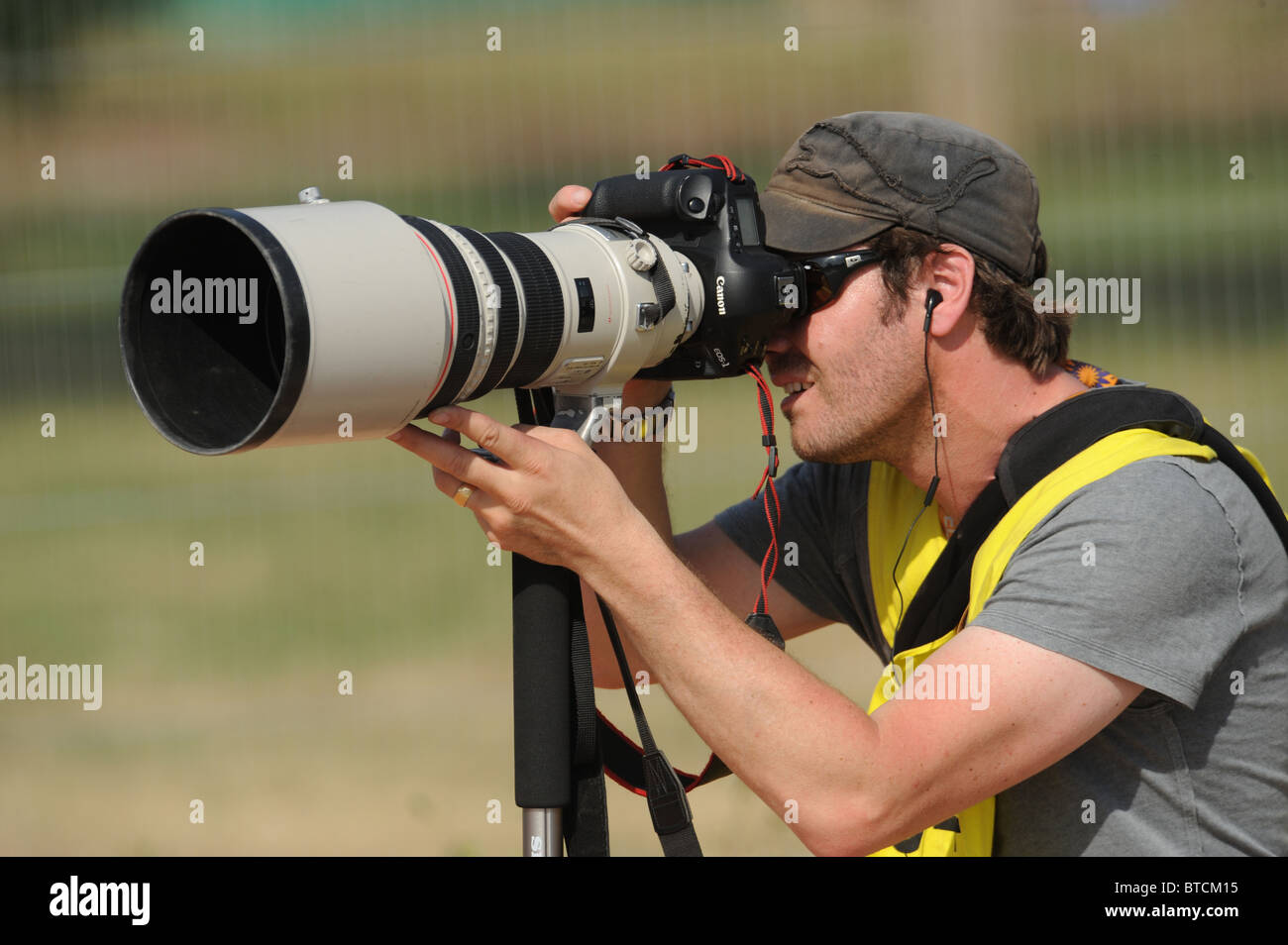 Professional photographer using a telescopic lens Stock Photo