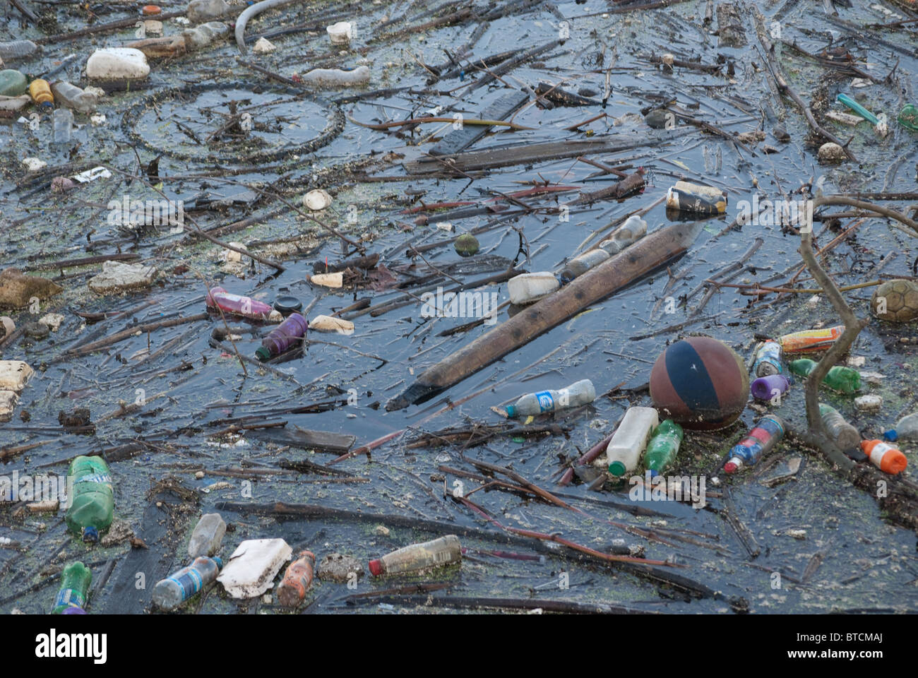Flotsam and jetsam  or filth and pollution - Stock Image