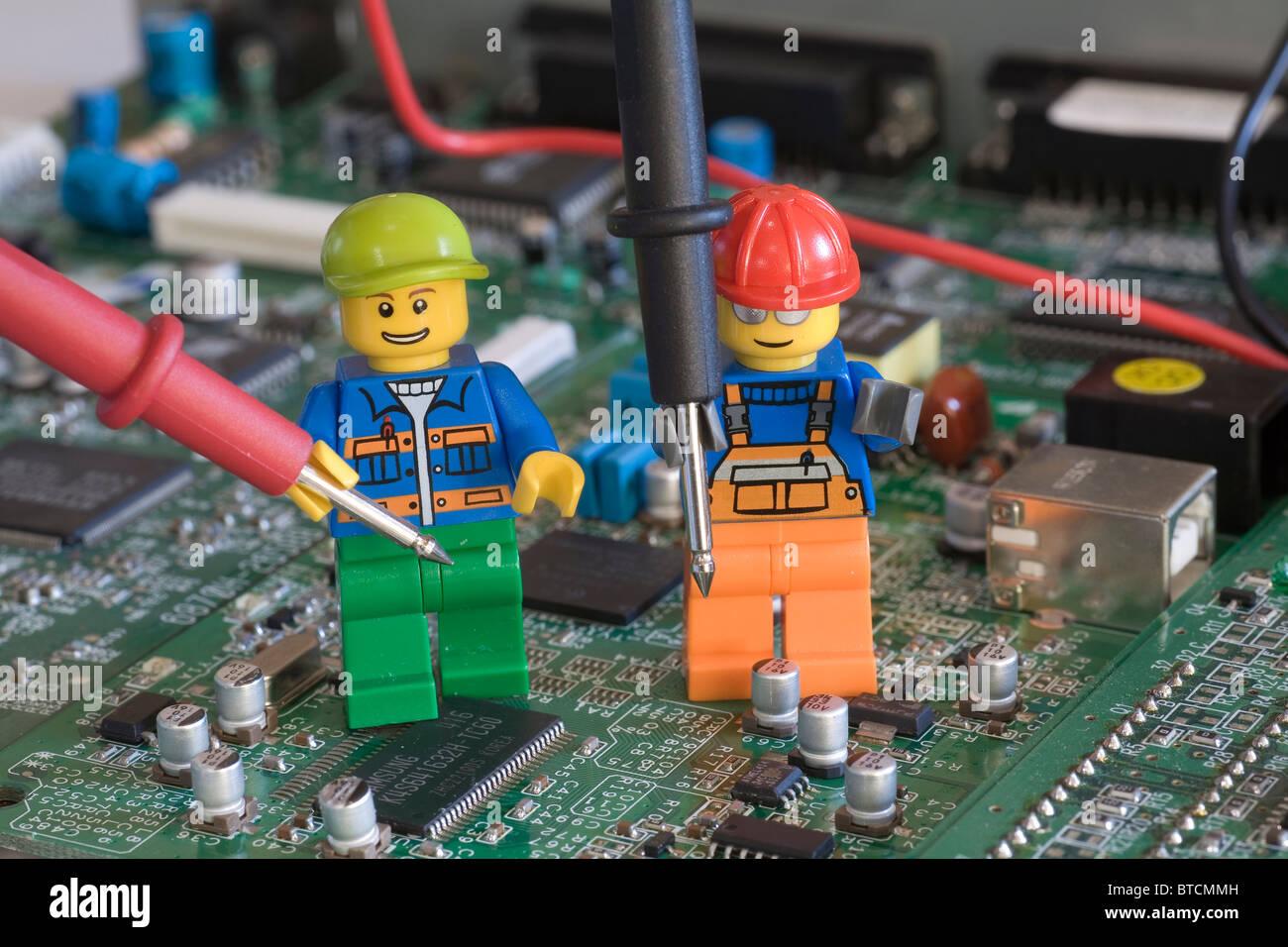 lego engineers on an electronic circuit board with testing probeslego engineers on an electronic circuit board with testing probes
