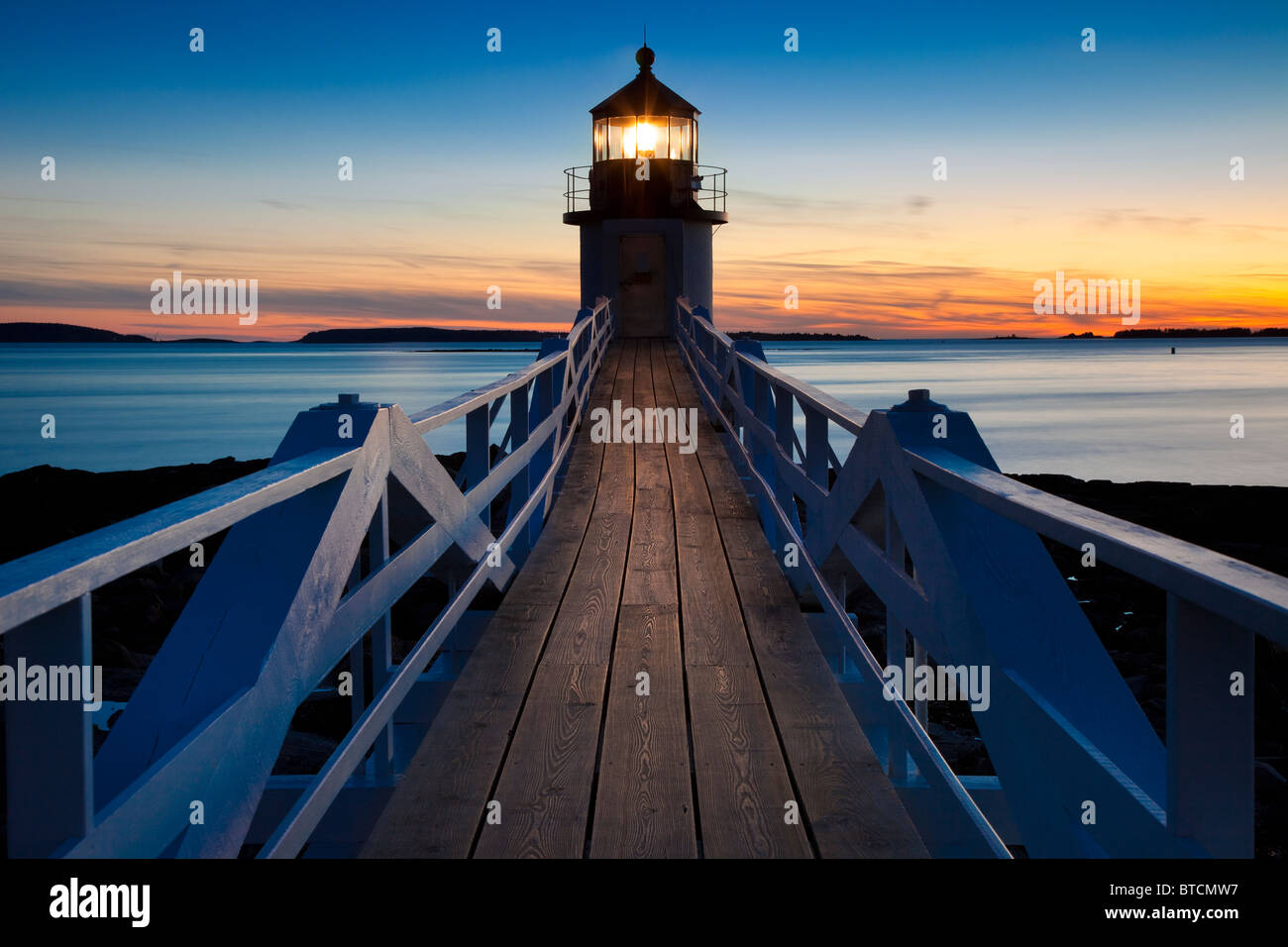 Sunset at Marshall Point Lighthouse - built 1832, near Port Clyde Maine USA - Stock Image