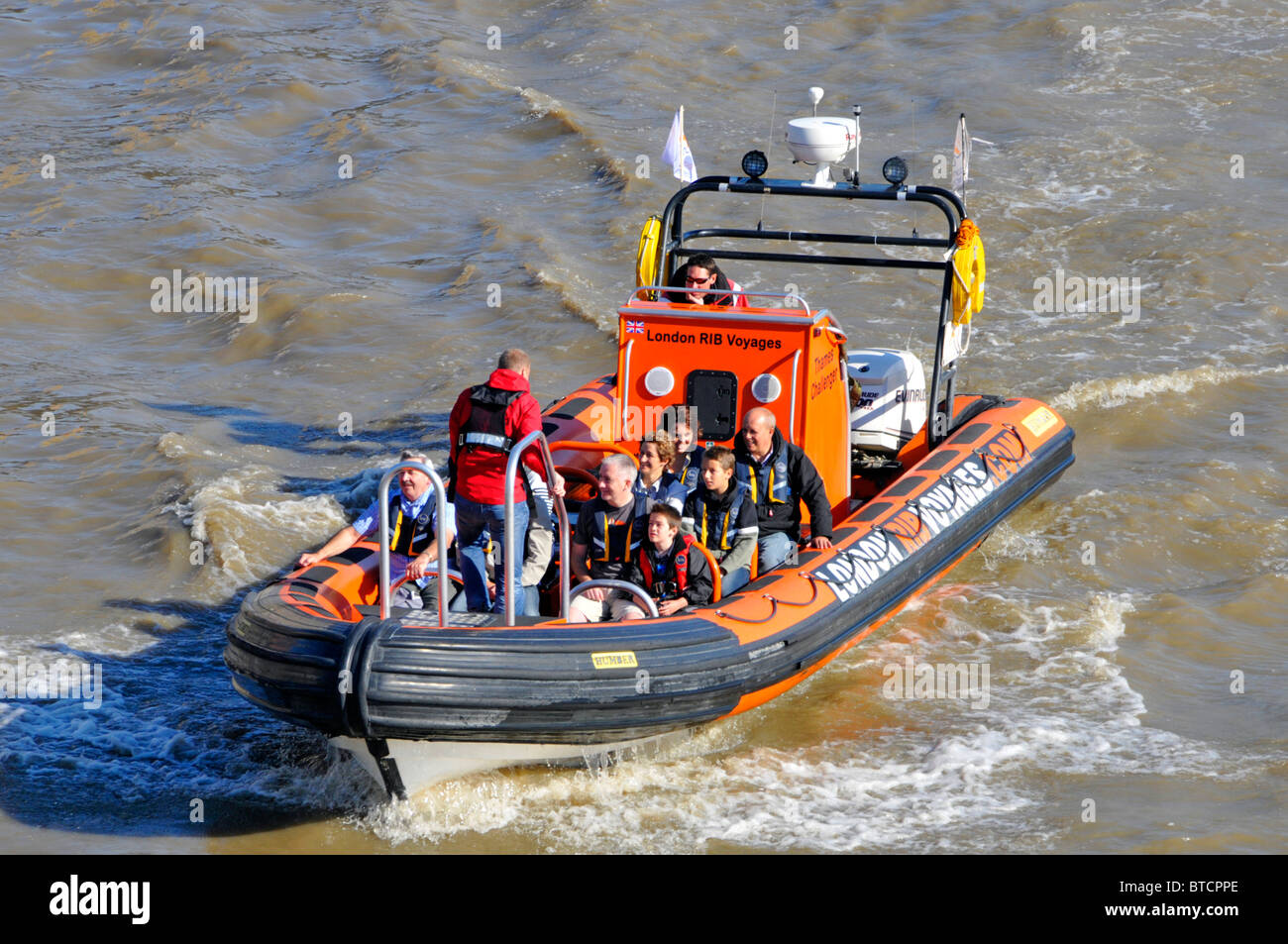 Tourist guide and passengers on London Rib Voyages high speed tour boat - Stock Image