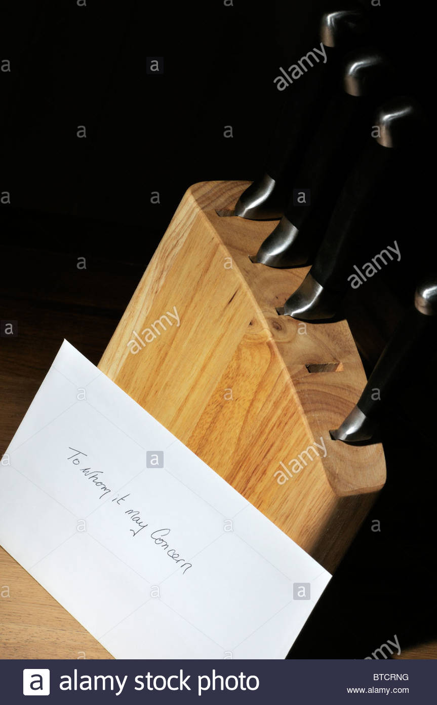Suicide note propped up against missing knife, England UK United Kingdom GB Great Britain Europe - Stock Image