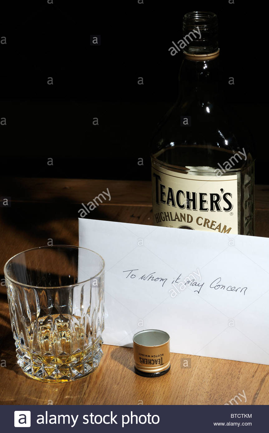 Close up image of a To Whom It May Concern suicide note left on kitchen table alongside a bottle and tumbler of - Stock Image