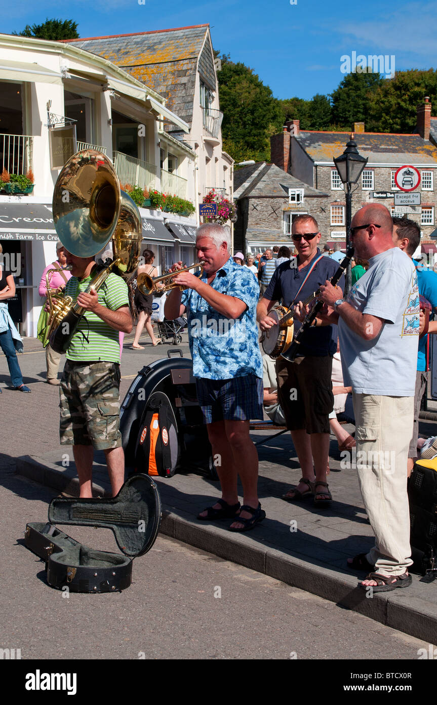 Buskers playing by the Harbour in Padstow, Cornwall, UK - Stock Image